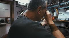 RAMAT GAN, ISRAEL, JULY 21 2016 -worker in a diamond polishing workshop Stock Footage
