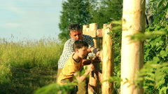 Father teaches his son to do the fence. Stock Footage