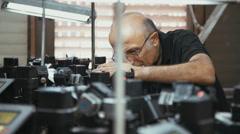 RAMAT GAN, ISRAEL, JULY 21 2016- worker inspecting diamond polishing machines Stock Footage