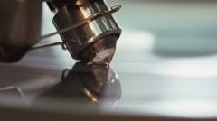 Macro shot of a diamod polishing machine Stock Footage