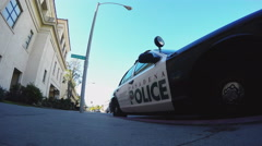 Low Angle Pasadena California Police Car Parked On Road Stock Footage