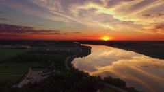 Dramatic aerial view of spectacular colorful sunrise over smooth river waters Stock Footage