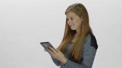 Redhead on social media - tablet computer Stock Footage