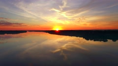 Spectacular aerial view of spectacular colorful sunrise over smooth river waters Stock Footage