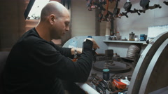 RAMAT GAN, ISRAEL, JULY 21 2016 - professional diamond polisher Stock Footage