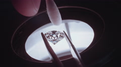 Close up of a gemologist inspecting a large diamond under a microscope Stock Footage