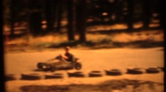 8mm Vintage, home movies racing cars with children Stock Footage