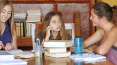 Three teenage girls learn together with books - dolly Stock Footage