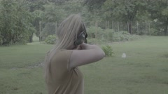 Young Woman Fires Flintlock Rifle at Jug Stock Footage