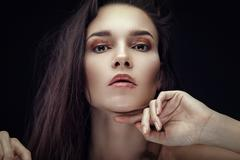 Fashion beauty portrait of brunette with chaos hairstyle Kuvituskuvat