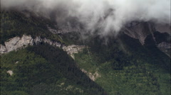 Clouds Tumbling Down Mountain Sides Stock Footage