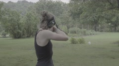 Young Woman Fires Flintlock Rifle at Target Stock Footage