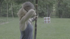 Young Woman Fires an Arrow at a Target Stock Footage