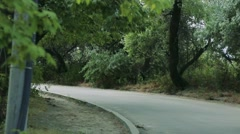 Man rides a skateboard on the road Stock Footage
