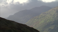 Low Grey Cloud Over Mountains Stock Footage