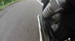 Motorcycle exhaust pipe while driving. Close up Stock Footage