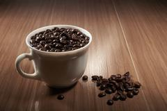 Full cup of black coffee Stock Photos