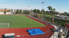 High Angle Pan Shot Soccer Field And Track - Biola University Stock Footage