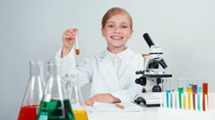 Portrait chemist conducting experiments. Child girl holding a test tube Stock Footage