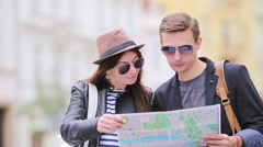 Happy tourist couple traveling on holidays in Europe smiling happy. Caucasian Stock Footage