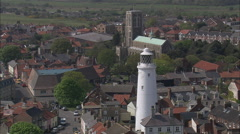 Southwold Lighthouse Low With Church And Town In The Background Stock Footage