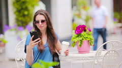 Fashion happy girl talking by phone after shopping drinking coffee in openair Stock Footage