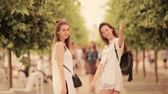 Follow me concept. Happy young urban women in european city. Caucasian tourists Stock Footage
