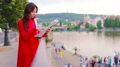 Happy young woman with a city map in Europe. Travel tourist woman with map in Stock Footage