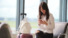 Airline passenger in an airport lounge waiting for flight aircraft. Caucasian Stock Footage