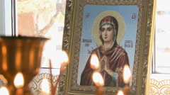Wax candles in the Church burn.On the background of the icon.An Orthodox Church. Stock Footage