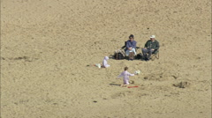 Tourists On Clacton Beach Stock Footage