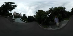 360Vr Video Man Walking Filming Puppet Show Theatre Kiev Cloudy Day Park Around - stock footage