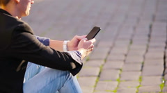 Closeup of male hands is holding cellphone outdoors on the street. Man using Stock Footage