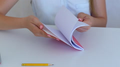 Student female hand leaf copybook in white room education concept Stock Footage