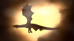 Silhouette of a Dragon Flying Against the Sun Waving his Wings - stock footage