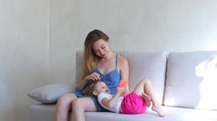 Mother daughter play use phone and family concept hugs Stock Footage