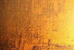 Golden grainy background Stock Photos
