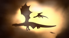 Silhouette of a Herd of Dragon Flying Against the Sun Waving their Wings Stock Footage
