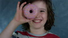 4k Shot of a Cute Child Posing with a Donut on his Eye Stock Footage