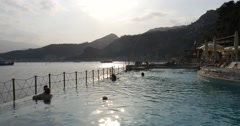 People Relaxing in a Pool on a Sunset, Taormina, Sicily Stock Footage