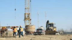 Builders go to the background construction site Stock Footage
