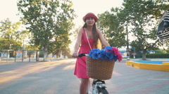Young attractive girl riding on vintage bike at the morning, slow motion Stock Footage