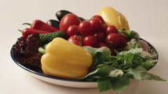Turning vegetables on white background, pear, tomatoes, pepper, salad Stock Footage