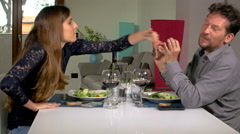 Funny couple fighting during lunch at home 4K Stock Footage