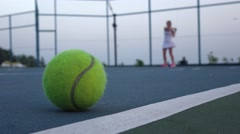 Tennis court with tennis balls and player Stock Footage