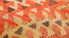 Turkish kilim with orange and brown zigzag pattern Stock Footage