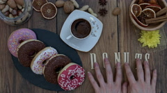 4k Donuts Composition on a Wooden Background with word Doughnuts Stock Footage