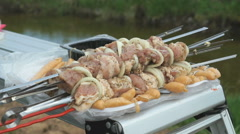 Man takes the skewers with fresh meat for roasting Stock Footage
