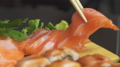 Sashimi Salmon Close Up, Chopstick Takes One Piece Stock Footage