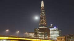 LONDON, UK - 2016.07.19: Time-Lapse at Night at the Shard in London at Full Moon - stock footage